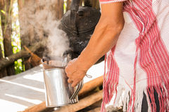Hill tribe barista pours fresh coffee into mug Stock Image
