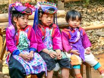 Hill tribe children. Chiang Mai, Thailand - 19th February 2005: Hill tribe children sat on a bench. Villagers expect donations from visitors royalty free stock photography