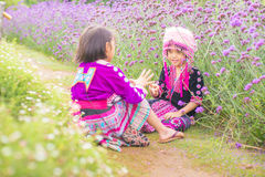 Hill tribe children playing with friend with traditional clothes Stock Image