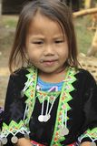 Hill tribe girl. LUANG PRABANG, LAOS - FEBRUARY 11: A young girl in traditional Hmong hill tribe dress with elaborate head 11th February, 2015 stock photos