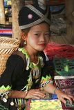 Hill tribe girl. LUANG PRABANG, LAOS - FEBRUARY 11: A young girl in traditional Hmong hill tribe dress with elaborate head 11th February, 2015 stock photography