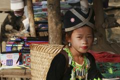 Hill tribe girl. LUANG PRABANG, LAOS - FEBRUARY 11: A young girl in traditional Hmong hill tribe dress with elaborate head 11th February, 2015 stock image