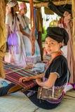 Hill tribe girsl demonstrating weaving fabric. CHIANGMAI, THAILAND - JANUARY 24, 2015: Hill tribe girl demonstrating weaving fabric in 22nd Traditional Skirt stock images