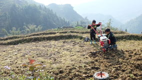 Hill tribe kids in Sapa, Vietnam. They woking by repairing machine on the mountain royalty free stock image