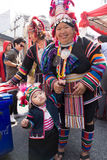 Hill tribe ladies and child. In the city stock images