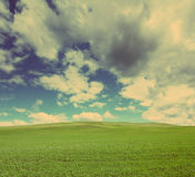 Hill under cloudy sky - vintage retro style Stock Photo