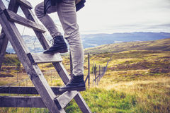 Hill walker crossing style and fence Royalty Free Stock Photo