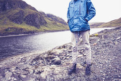 Hill walker standing by mountain lake Royalty Free Stock Photography