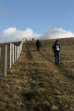 Hill walkers. Hill walkers enjoying the great outdoors on a grassy mountainside  with blue sky and cloud Stock Photo
