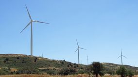 Hill with windmills in Larnaca, Cyprus. Renewable energy resource of alternative energy production. Green hill with windmills in Larnaca, Cyprus. Wind power stock footage