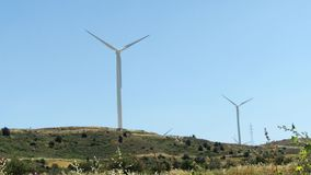 Hill with windmills in Larnaca, Cyprus. Renewable energy resource of alternative energy production. Green hill with windmills in Larnaca, Cyprus. Wind power stock video
