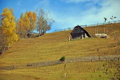 Hill and wooden house Royalty Free Stock Images