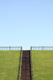 Hill with wooden stairs Stock Image