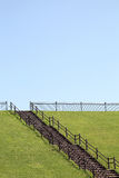 Hill with wooden stairs. And blue sky Stock Photography