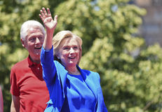 Hillary and Bill Clinton. Newly announced presidential candidate Hillary Rodham Clinton waves to supporters while her husband, forrmer president Bill Clinton royalty free stock photography