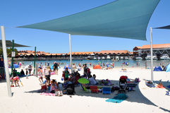 Hillarys Boat Harbour: Shade Sails. HILLARYS,WA,AUSTRALIA-JANUARY 22,2016: Shade sails at Hillarys Boat Harbour beach with tourists swimming in the cove at royalty free stock images