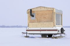 Hillbilly camping. Home made Ice fishing trailer Stock Photo