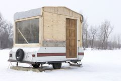 Hillbilly camping. Home made Ice fishing trailer Stock Photography