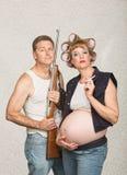 Hillbilly fêmea grávido de fumo Fotografia de Stock