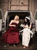 Hillbilly Wedding. Bride and cross dressing bridesmaid at Hillbilly Wedding Stock Photo