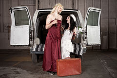 Hillbilly Wedding. Bride and cross dressing Groom at Hillbilly Wedding Royalty Free Stock Images