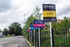 HILLINGDON, LONDON, ENGLAND - 14 August 2021: Sold signs outside a property