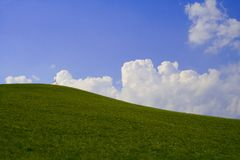 Hilll, sky and clouds. Excellent background royalty free stock image