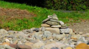 Hillock of stones. A hillock of stones with blurred background and foreground stock image
