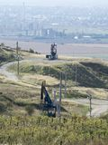 Hills around Ploiești, Romania. View of the hillside area around the city of Ploiești, Romania. Oil pumps visible Royalty Free Stock Photos