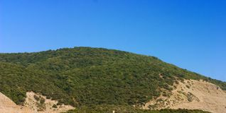 Hills with blue sky. On background Stock Photography