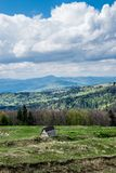 Nature of Ukrainian mountains. Hills of Carpathian Mountains in Ukraine. Natural landscape with awaking colors of forest in spring under cloudy sky royalty free stock photography