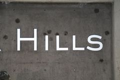 Hills- cement sign for billboards or wallpaper for the name Hills!. Famous Scottish and English name is Hills! Hills sign is perfect to use for magazine covers stock photo