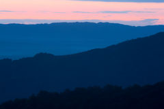 Hills at dawn. Hills fading into the mists of dawn Stock Photos