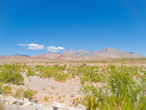 Hills in distance under clear blue sky Red Rock Canyon Stock Images