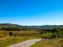 Hills, fields and meadows - typical views of Tuscany. Travel, nature and agriculture concept. Vacations in Italy. Copy space royalty free stock photo