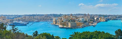 Panorama of fortified cities in Valletta Grand Harbour, Malta. The hills of Floriana are perfect viewpoints to observe the fortified settlements of Valletta Stock Photos