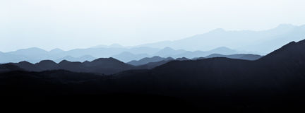 Hills in the fog Royalty Free Stock Photo