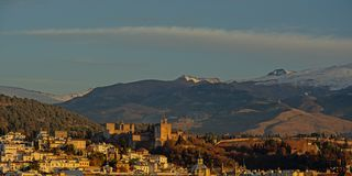 Hills of Granada, with Albayzin neighborhood and Alhambra with Sierra Nevada mountains with snow tops behind Royalty Free Stock Photos
