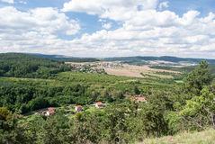 Hills with huge forests and countryside with villages and fields bellow Royalty Free Stock Photo