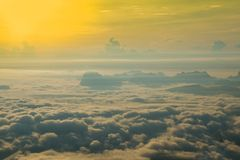 Fog beautiful. Hills increased from fog Sunrise morning - Beautiful rising sun in the early morning over sea of fog on hill royalty free stock photography