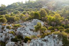 Hills of Kekova, ancient city, green trees, Turkey. Concept of travelling and famous places royalty free stock images