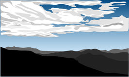 Hills landscape with white clouds on blue sky. Stock Image