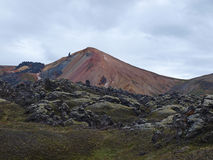 Hills on the Laugavegur hike, Iceland. Rhyolyte coloured hills, past some lava flow Stock Photography