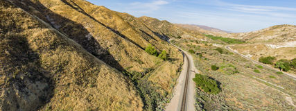 Hills Lead to Desert Railroad. Railroad tracks at the base of desert foothills in the Mojave of California Stock Photography