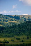 Hills in light and shadow. In the Apuseni Mountains in Romania, a nice holiday target stock photo