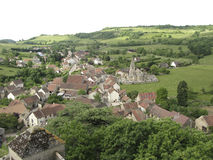 Hills and medieval village of Rochepot in France Stock Photos