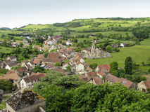 Hills and medieval village of Rochepot in France stock photo