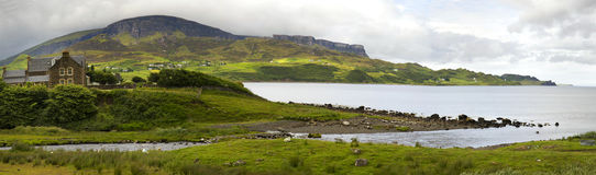 Hills and mountains on isle of skye. Beautiful landscape with mountains, hills and house at Garrafad, isle of skye, Scotland Stock Photography