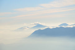 Hills and mountains in the mist. Vista taken from Dobrca, Slovenija, 1500m Royalty Free Stock Photography