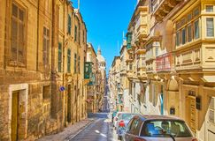 The hills of old Valletta, Malta. Explore the hilly landmscape of Valletta, walking its historical streets with preserved housing and many landmarks, Malta stock photography